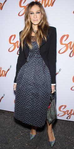 Sarah Jessica Parker elevated polka dots to eveningwear status when she hit the opening night of Sylvia in a spotted navy cotton Dior midi-length dress that she styled with a sharp blazer, a metallic purse, and shimmery pumps.