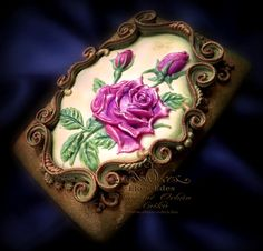 Shining bas relief rose on chocolate cookie or dark gingerbread by Anikó Vargáné Orbán
