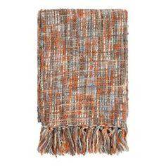 """Earth-toned woven throw with a fringed border.      Product: Throw Construction Material: 100% Acrylic Color: Multi       Dimensions: 50"""" x 60""""   Cleaning and Care: Blot stains"""