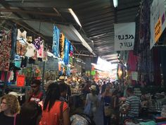 """The Carmel Market, known in Israel as """"Shuk Ha'Carmel"""", is the city's biggest marketplace, and a fascinating, enjoyable place to visit. It is basically one crowded narrow alley with long line of colorful stalls standing on either side, and where vendors proudly (and loudly) presenting their goods. Here you can find almost anything imaginable for the lowest prices in the city, from different kinds of bread and pastry to delicious olives, dried fruits and exotic spices."""