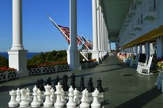 Lounge on the World's Longest Porch at the Grand Hotel on Mackinac Island, Michigan | MapQuest.com #99summerquests