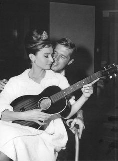 """George Peppard and Audrey Hepburn, on the set of """"Breakfast at Tiffany's"""" Interesting the juxtaposition of her morning window scene hair with her balcony scene."""
