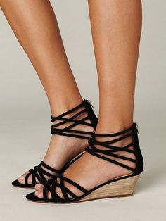 Love the little wedge and edgy detail   Queen Wedge Sandal - Free People. I've been looking for a wedge that isn't too tall. These are perfect!!