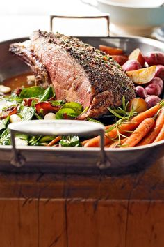 Here's a holiday roast your friends and family are sure to devour to the final ounce. Warm veggies are tossed in a savory herb-bacon topper and cooked until tender to make your holiday dining experience even more scrumptious. #christmasmenu #christmasdinner #holidayfoods #christmasmenuideas #holidayrecipes #bhg