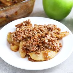 This delicious and healthy apple crisp is super easy to whip up and easily made glutenfree and vegan Cinnamon baked apples topped with the crispy nutty oatmeal topping is perfection. Vegan Desserts, Delicious Desserts, Dessert Recipes, Yummy Food, Tasty, Healthy Apple Desserts, Paleo Apple Recipes, Green Apple Recipes, Healthy Recipes