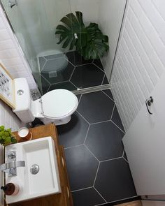 Tiny bathroom with zero entry shower, vessel sink, white tile walls, grey tile floors