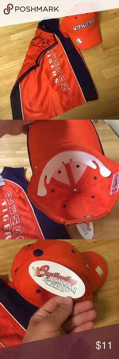 Clemson Tigers hat and signed jersey New with tags Clemson hat and children's basketball jersey signed. (I believe by Trevor booker but idk). The jersey is sort of a bonus add on item and would also fit a small dog. Make an offer! clemson Accessories Hats