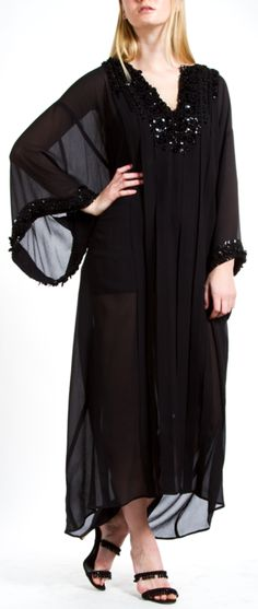 Make a fashion statement with this black chiffon oversized embellished Oscar (2008) dress! I love this as an evening look, or paired with flats for a dinner on vacation. Size tag says it's a Medium. I usually wear a US 12-14 and it fits me. Model is a US 4. Sheer, needs slip.