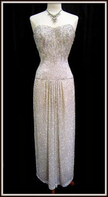 1960s strapless fully beaded gown with a fabulous draped skirt.