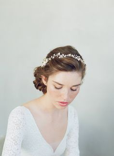 This amazing and original Twigs & Honey concept will make you rethink your bridal accessory! This lovely style can be worn alone as a hair vine, a necklace or even as a double wrap bracelet. It can also be connected to our style 7011 to create a full halo! You can mix and match your bridal look. Wear this style as a full halo with comb 7011 during the ceremony and as an option, you could disconnect the vine and wear as a bracelet during the reception or even long after your big day. ...