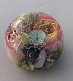 Assortment of wedding flowers preserved into a wedding flower paperweight
