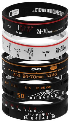 "Back in 2010, San Diego-based photographer Adam Elmakias launched a geeky fashionable line of gel bracelets based on various lenses. The Lens Bracelets took the web by storm, and now Elmakias is back with a new and improved ""pro series"" lineup of bracelets that are much more faithful representations of actual lenses by Canon, Nikon, Leica, and Zeiss. The new bracelets are based off $25K+ worth of popular cameras lenses, and are more detailed and more durable than the previous version."