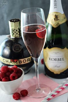 Signature drink - Blackberry Champagne Bellini - 4 oz champagne, oz Chambord, fresh raspberries - Pour Chambord into the bottom of the champagne flute. Add champagne and a raspberry to the glass and serve. New Year's Eve Cocktails, Wine Cocktails, Cocktail Drinks, Cocktail Recipes, Chambord Cocktails, Bellini Cocktail, Champagne Drinks, Party Drinks, Fun Drinks
