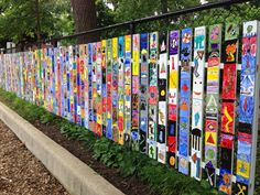 These are fence posts used for a fifth grade transition project to leave behind after graduation to middle school. Each student painted a board with symbols to represent their elementary school experience and wisdom for future 5th grade classes. Pallet boards would be ideal material to repurpose for this project.