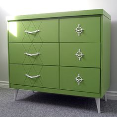 a tired mid-century dresser transformed into a modern piece of art