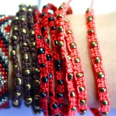 """Red """"Xubal Handmade Triple Wrap Bracelet"""" In Red with black beads, 26"""" around, 100% Poly Waxed Thread, Metal Beads, Handmade by skilled artisans in Guatemala, mix & match! For sale as individuals or with Ketzali """"Tzuel Textile Pouch""""- $32., with Makeup bag- $42, with Makeup bag, Pouch, and 1 Bracelet- $58, with 2 Bracelets- $72. Ketzali Jewelry Bracelets"""