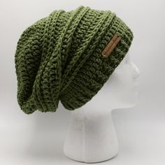 "Hand crocheted with 100% acrylic fibers in a stunning ""Sage Green"" color, this hat is perfect for autumn/fall wear and into the winter season. Other colors also available and Ready To Ship!  https://www.etsy.com/listing/470066497/slouchy-hat-womens-slouchy-hat-green?ref=shop_home_active_2"