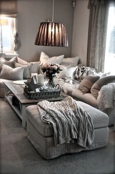 .Lounge: Grey comfy couch and low lying light fitting
