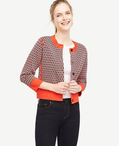 """Done in a vibrant leaf pattern, our jacquard sweater jacket is the perfect layer for in between seasons. Ribbed jewel neck. 3/4 sleeves. Button front. Front flap pockets. 19 3/4"""" long."""