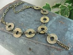 Token Jewelry - Genuine Upcycled Amusement Token Necklace - Industrial Chic Styling. $88.00, via Etsy.