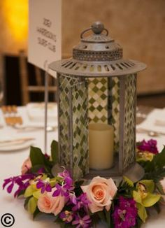 10 Lanterns used for centerpieces. Different colors (gray, purple, & green mixed) Beach Rustic look, looked awesome with fesh flowers around lantern (flowers not included).
