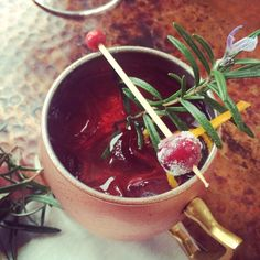 Holiday Cocktail Recipe: MERRY MULE —Cranberry, rosemary and citrus Moscow Mule via Monica Hart La Famiglia Design. Moscow Mule Copper Mug from west elm