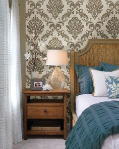 Elegant bedroom decor idea with a damask wallpaper feature wall behind the bed