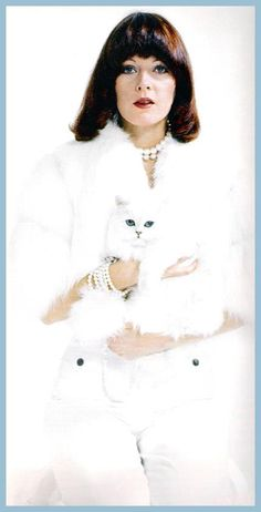No cat outfits here but real cats: Frida with cat in 1975..ABBA