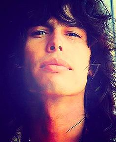 Steven Tyler from Aerosmith  Great singer with great unique style shown in his way of bring music to our world & his not afraid to be his authentic self& made it through hard times more than once. Aerosmith is one of the groups that has most helped me through hard times <3=<3