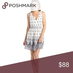 Paisley Open Strappy Back V Neck Dress Flirty and cute, this dress is summer perfection! Dresses Mini