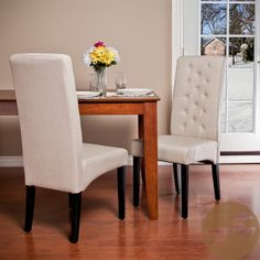 These tall-back fabric dining chairs showcase a breathtaking slender silhouette, a tufted design, crisp white upholstery, and an armless design that gives a magazine-worthy appearance that will inspire you to have guests over as often as possible.