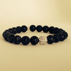 Single black ebony bead bracelet by Bestowed Beads. Elegant and simply stated. Great to wear with a blazer, T-shirt and jeans or business attire. Very versatile piece that can go with anything.