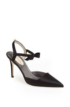 black satin sling back pump with a bow-trimmed ankle strap.