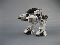https://flic.kr/p/dV94yg | Mini LEGO ED-209 from Robocop | This is a minifig scale ED-209 from the movie Robocop. ED-209 must be the best robot bad guy ever! The shoulders, elbows, waist, hips and toes(!) are all articulated. Many thanks to Billyburg for a tip on the leg pistons.