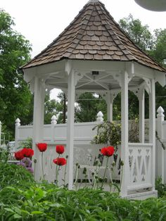 Gazebo in spring with poppies. (Prospect Valley Hospitality renovated historic 1872 property, Wheat Ridge, Colorado, USA)