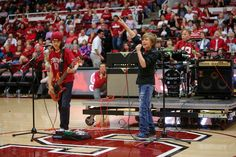 Rock band WJM, from left, Jeremy, William and Max, performs during halftime of the Stanford women's basketball game on March 1, 2014, at Maples Pavilion (John Green/Bay Area News Group)