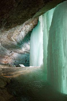 frozen Minnehaha Falls, a 53-foot waterfall located in Minnehaha Park, Minnesota, USA // Ice Climb? Love this shade of green!