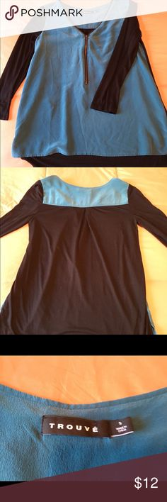 Silk two-tone, hi-lo blouse/top Fun zip-front blouse with a silk blue front and black rayon 3/4 sleeves and back. From Trouvé, size small. Like the NY&Co black slacks in the cover pic? They're for sale, too! Trouve Tops Blouses