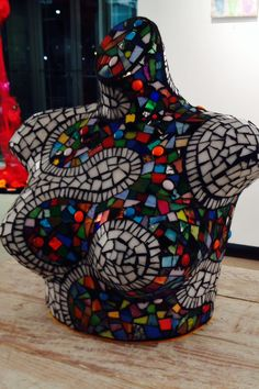 Mosaic done on an old bra mannequin. Stained glass.
