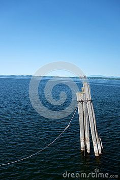 Photo about This is pier piling marking the entrance of a ferry pier port terminal with nautical lights on Lake Champlain in Vermont. Image of blue, terminal, marker - 74462386 Lake Champlain Vermont, Nautical Lighting, Boats, Entrance, Ships, Stock Photos, Lights, Blue, Image