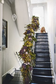 A simple yet stunning way to bring Christmas to your hallway is with a large foliage garland. Natural decorations also have the added advantage of a gorgeous fragrance. Here, the combination of metallics with pretty lavender hues looks modern. It was designed by Nikki Tibbles of florist Wild at Heart.  Image: Livingetc
