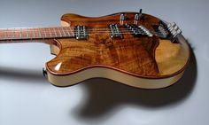 """2010 Hehnke Guitars Jazz - """"Chambered spruce body with deep carved walnut top. Maple and walnut neck with snakewood fingerboard. Custom Toone headless hardware. NOS Filtertron pickups."""""""