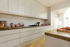 Modern Handless Kitchen - designed by Cue & Co of London 4