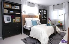 The High Low Project on HGTV- Hanging curtains high above the windows makes this bedroom feel roomier, as seen on HGTVs The High Low Project. Placing the bed in front of one of the windows opens up wall space for bookcases and other storage without blocking the natural light.