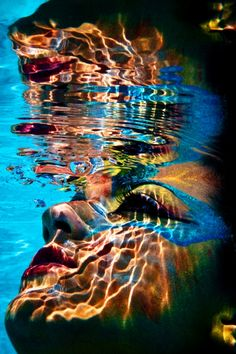 colorful face in water