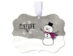 Personalized Girls/Boys Christmas Ornament. This will be a cherished keepsake for many years to come. All of my ornaments are custom made and are one of a kind. ---------Ornament Details--------- Each ornament comes attached with a coordinating ribbon for hanging. Measures approximately 2.75 in diameter Made out of porcelain ceramic The artwork is permanently fused to the ornament (This is not a decal) If this is being shipped directly to the recipient I can place a small personalized note…
