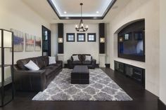 Second floor media room in Villa Sirena, a home by Orlando Custom Home Builder Jorge Ulibarri. Decor by Karen LeBlanc