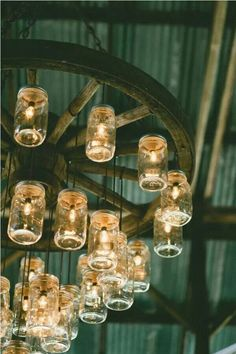 Of I had a barn converted to studio and entertainment space  Wagon wheel and jelly jars chandelier
