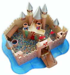 Cardboard castle- good use of paper tubes. Good idea for littlest pet shop and squinkies