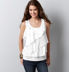 We layered an array of fluttery asymmetrical tiers together for a hopelessly romantic look. Scoop neck. Sleeveless. Banded neckline and armholes.